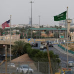 A Saudi Arabia's and United States' flags are seen on Mecca Road as security check point are set up ahead of the visit of the United States President Donald Trump, in Riyadh