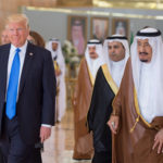 Saudi Arabia's King Salman bin Abdulaziz Al Saud walks with U.S. President Donald Trump during a reception ceremony in Riyadh