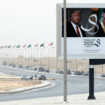 Trump's motorcade passes a billboard advertising his visit with Saudi Arabia's King Salman upon his arrival in Riyadh, Saudi Arabia