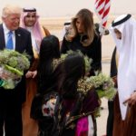 Saudi Arabia's King Salman, Trump and the first lady are greeted with flowers by children in an arrival ceremony at King Khalid Airport in Riyadh