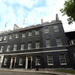 Union flags stand at half-mast on the roof of 10 Downing Street in London