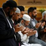 Muslim men pray for victims of the attack at Manchester Arena at a mosque in Manchester