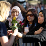People take part in a vigil for the victims of an attack on concert goers at Manchester Arena, in central Manchester