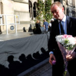 Tim Farron, the leader of Britain's Liberal Democrat Party, takes part in a vigil for the victims of an attack on concert goers at Manchester Arena, in central Manchester