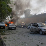 Damaged cars are seen at the site of a blast in Kabul, Afghanistan
