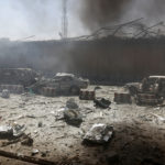 Damaged cars are seen after a blast at the site of the incident in Kabul, Afghanistan