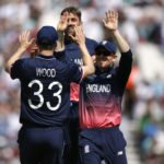 England's Mark Wood celebrates catching out Bangladesh's Imrul Kayes with Eoin Morgan