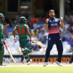 England's Liam Plunkett celebrates taking the wicket of Bangladesh's Imrul Kayes