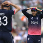England's Joe Root and Mark Wood react after a missed chance
