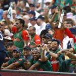 Bangladesh fans react after England's Ben Stokes fell over the boundry
