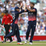 England's Liam Plunkett and Eoin Morgan celebrate taking the wicket of Bangladesh's Tamim Iqbal