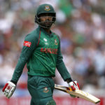 Bangladesh's Tamim Iqbal walks off after losing his wicket