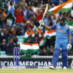 India's Rohit Sharma celebrates reaching his half century