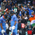 India fans celebrate six runs