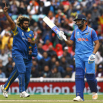 Sri Lanka's Lasith Malinga celebrates taking the wicket of India's Rohit Sharma (R)