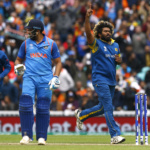 Sri Lanka's Lasith Malinga celebrates taking the wicket of India's Rohit Sharma (L)