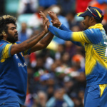 Sri Lanka's Lasith Malinga (L) celebrates taking the wicket of India's Rohit Sharma (not pictured)