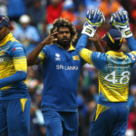 Sri Lanka's Lasith Malinga (C) celebrates taking the wicket of India's Rohit Sharma (not pictured)