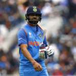 India's Virat Kohli walks off dejected after losing his wicket