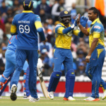 Sri Lanka's Asela Gunaratne (R) celebrates taking the wicket of India's Yuvraj Singh