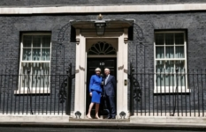 Britain's Prime Minister Theresa May and her husband pose at number 10 Downing Street in London