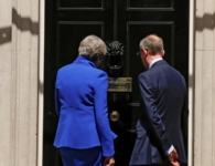 Britain's Prime Minister Theresa May and her husband walk into number 10 Downing Street after she addresses the country in London