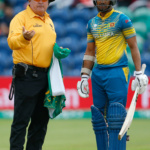 Sri Lanka's Danushka Gunathilaka talks with umpire Marais Erasmus