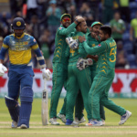 Pakistan's Fahim Ashraf celebrates with teammates after taking the wicket of Sri Lanka's Dinesh Chandimal