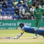 Sri Lanka's Angelo Mathews dives as Pakistan's Mohammad Hafeez unsuccessfully attempts to run him out