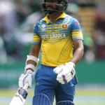 Sri Lanka's Niroshan Dickwella looks dejected after being dismissed