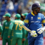 Sri Lanka's Suranga Lakmal walks off after being bowled by Pakistan's Hasan Ali