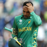 Pakistan's Fakhar Zaman walks off after being caught by Sri Lanka's Nuwan Pradeep