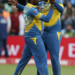 Sri Lanka's Nuwan Pradeep celebrates as Pakistan's Babar Azam is caught by Asela Gunaratne