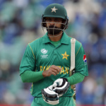Mohammad Hafeez of Pakistan walks off after being caught by Thisara Perera of Sri Lanka