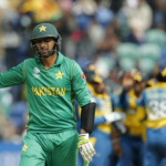 Pakistan's Shoaib Malik walks off after being caught by Sri Lanka's Niroshan Dickwella