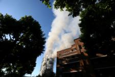 Smoke billows as firefighters tackle a serious fire in a tower block at Latimer Road in West London, Britain