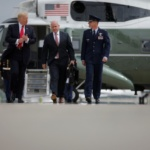 U.S. President Donald Trump walks toward Air Force One, accompanied by White House National Security Advisor H.R. McMaster as they depart Joint Base Andrews in Maryland