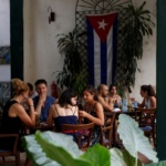 People sit at a restaurant in Havana