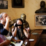 People sit at the Floridita bar, made famous by late U.S. writer Ernest Hemingway, in Havana