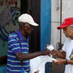 "A man buys plastic bags outside a subsidized state store, or ""bodega"", where Cubans can buy basic products with a ration book they receive annually from the government, in Havana"