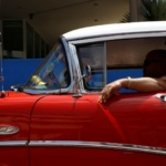 A man drives a vintage car in Havana