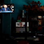 U.S. President Donald Trump is seen on a TV screen announcing his Cuba policy in a state-run bar in Havana