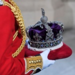Britain's Queen Elizabeth's crown is carried into the State Opening of Parliament in central London
