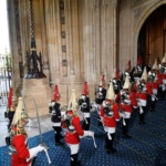 Members of the Household Cavalry arrive for the State Opening of Parliament in central London