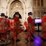 Yeoman Warders take part in the traditional 'ceremonial search' in the Peer's Lobby in the Houses of Parliament before the Queen's Speech during the State Opening of Parliament in central London