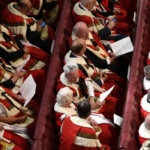 Peers take their seats in the House of Lords ahead of the State Opening of Parliament in central London