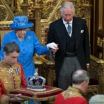 Britain's Queen Elizabeth stands with Prince Charles during the State Opening of Parliament in central London