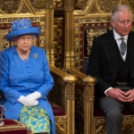 Britain's Queen Elizabeth sits next to Prince Charles during the State Opening of Parliament in central London